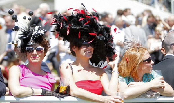 Horse Racing - The Oakes Day A lady wears a flamboyant hat at Epsom Racecourse